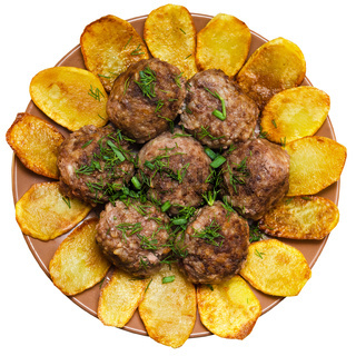 Fried meatballs with rice and French fries
