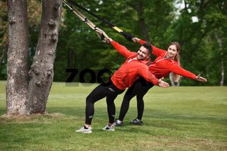 Sport man and woman training in park