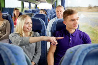 group of tourists in travel bus