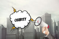 Charity text on speech bubble and businessman hand holding megaphone