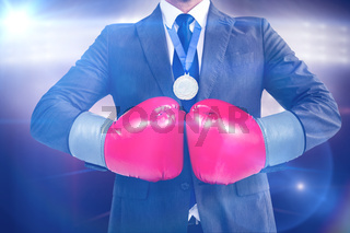 Composite image of businessman with boxing gloves