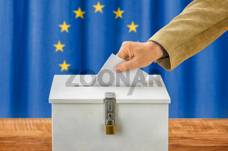 Man putting a ballot into a voting box - European Union