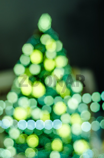 Decorated Christmas tree. Abstract blurred lights background