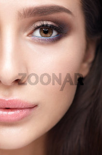 Half face female beauty portrait with aqua Limpet Shell color eye shadows, Snorkel Blue colour liner and Rose Quartz lips