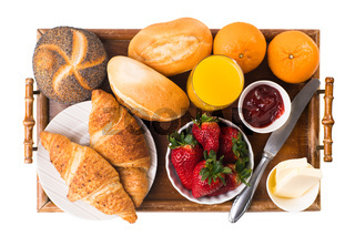 delicious breakfast with fresh croissants isolated on white