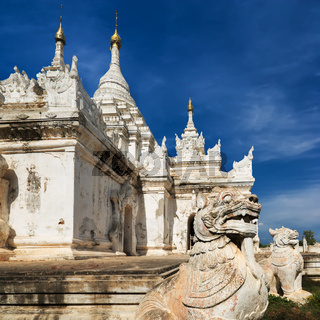 White Pagoda at Inwa city with lions guardian statues. Myanmar (Burma)