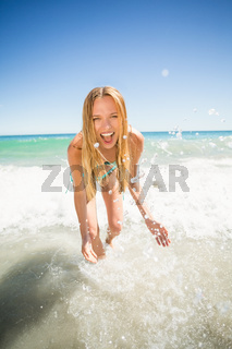 Young woman playing in water