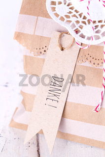 Gift bag with german 'DANKE' label tag for  seasonal greeting
