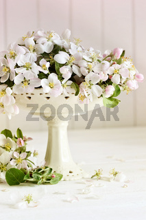 Fresh apple blossoms on table