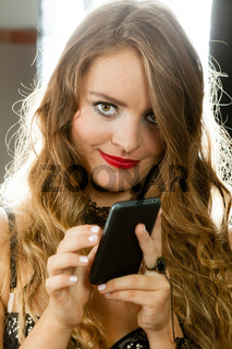 Sexy woman with smartphone