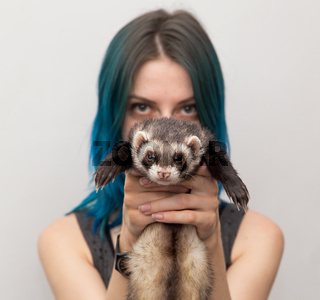 blue haired girl and ferret