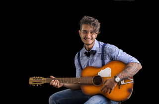 Portrait of cheerful man with guitar