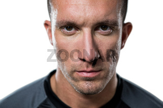 Close-up portrait of serious rugby player