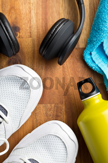 sport concept. headphones, shoes and bottle