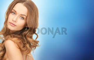 face of beautiful young happy woman with long hair