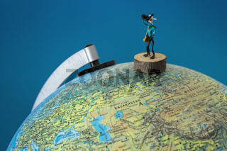 Wire model of a photographer taking a photo  on a globe. Concept globetrotting photographer.