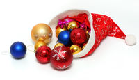 christmas balls, toys in red hat of Santa Claus