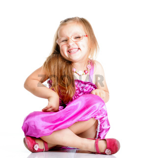 cute little girl sitting and smiling, isolated