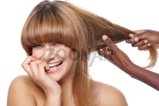 Beautiful happy woman getting her hair done
