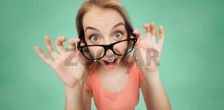 happy young woman or teenage girl in eyeglasses
