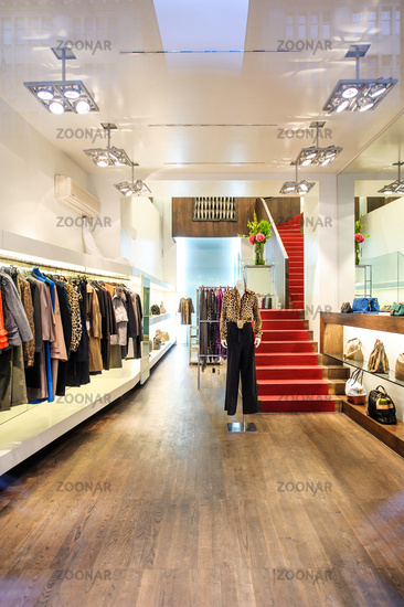 Interior of a boutique store with fashionable luxury women dresses