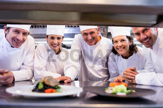 Team of chefs smiling at camera