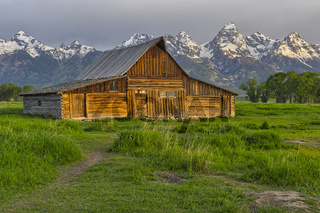 Old wooden Mormon barn on Mormon Row with the Teton Range in the background