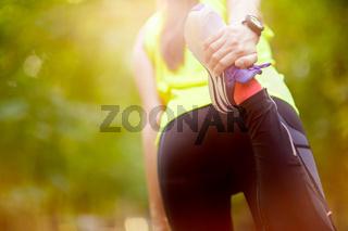 woman exercising with bent leg