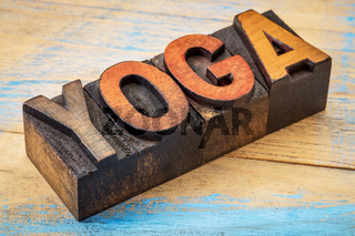 yoga word in vintage wood type