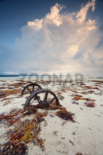 Rusty wheels in the sand
