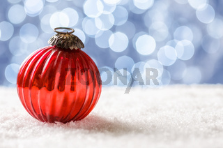 A christmas bauble in the snow