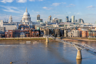 Millennium Bridge across Thames River and St. Paul's Cathedral in London
