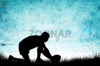 Composite image of silhouette of rugby player