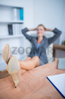 Smiling blonde businesswoman relaxing herself