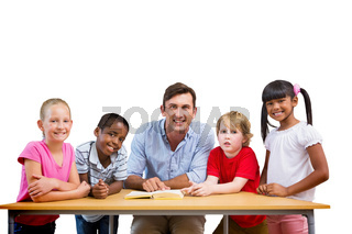 Composite image of teacher and pupils smiling at camera at library