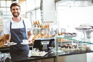 Smiling worker prepares breakfast