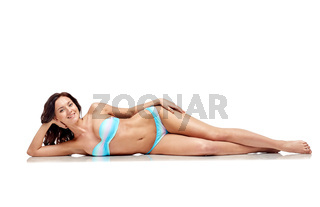 happy young woman lying in bikini swimsuit