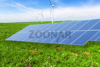 solar panel in wind power field in blue sky
