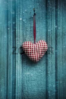 Christmas heart ornament hanging on door