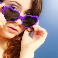 Girl in violet sunglasses portrait