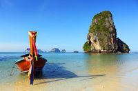 Long tail boat on tropical beach in Thailand