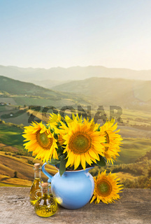 Collage with bouquet of sunflowers on Tuscany landscape background
