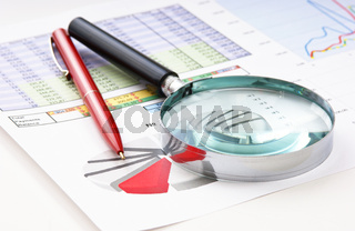 magnifying glass and the working paper