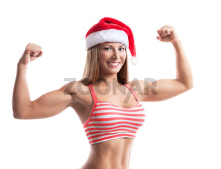 Fitness christmas woman wearing santa hat