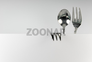 Figure of spoon and two forks
