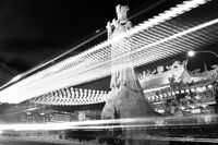 Temple Statue with lights from passing bus black and white. Taichung, Taiwan, Asia