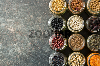 various dried legumes in jars