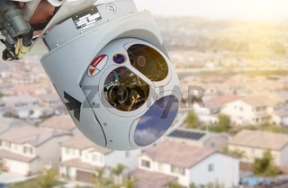Closeup of Drone Camera and Sensor Pod Module Above Neighborhood