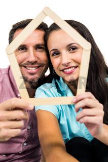 Couple holding house shape