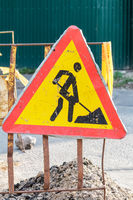 Construction Road Sign - Men at Work European sign as triangle shape with red border